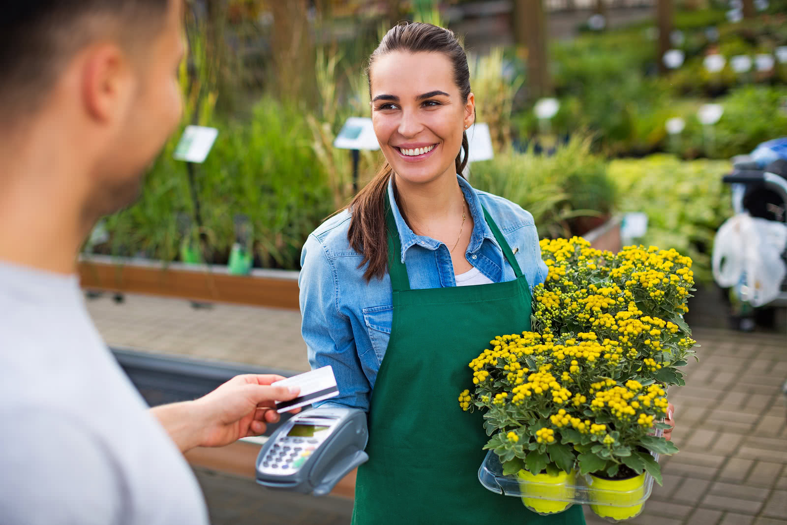 A landscaper buys inventory at a plant nursery with a credit card
