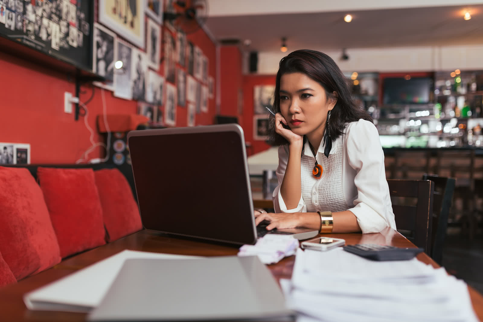 A restaurant owner searches for short-term loans for small business on laptop