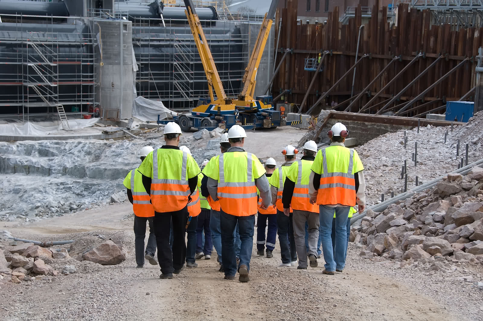 A group of construction workers walking away from a site