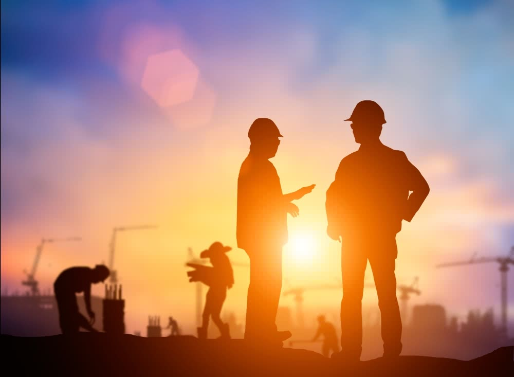 Silhouttes of two construction workers talking about saying no to new business