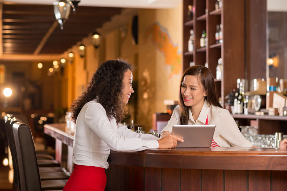 A restaurant manager and employee discuss goals to help with employee productivity during the holiday season