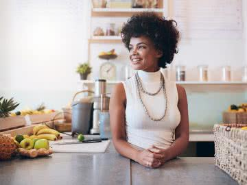 Juice bar owner standing proud of her female small business