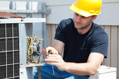 A business owner does maintenance work, a service outlined in his business plan for an HVAC company .