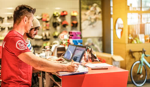 Two bike shop owners review small business accounting terms
