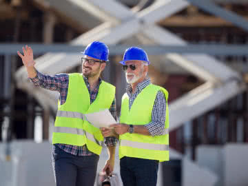 Consultant gives small business advice to a construction company owner